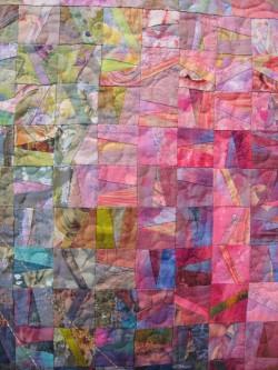 Subtle fabrics shimmer across art quilt