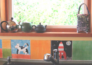 Tintin, toys, decorated folk art kitchen, artists home, hand painted ceramic tile backsplash