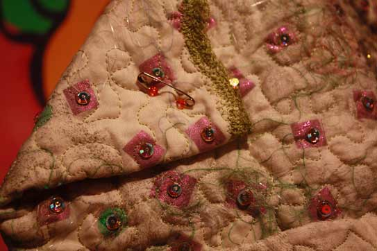 free-machine stitching on quilted hat, Swarovski Crystals, Pavelka circus hat embellishment