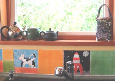 Tintin, toys, decorated folk art kitchen, artists home, hand painted ceramic tile backsplash