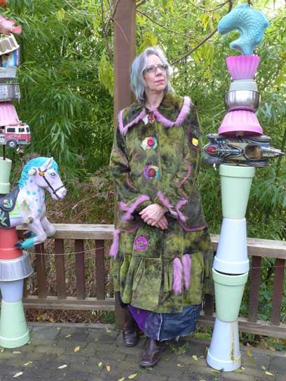 Paula O'Brien wearable art coat, fake fur, green shearling with pink tails