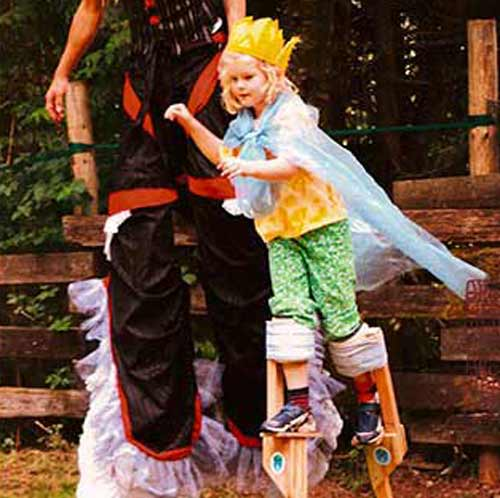 contemporary circus children photography, girl on stilts